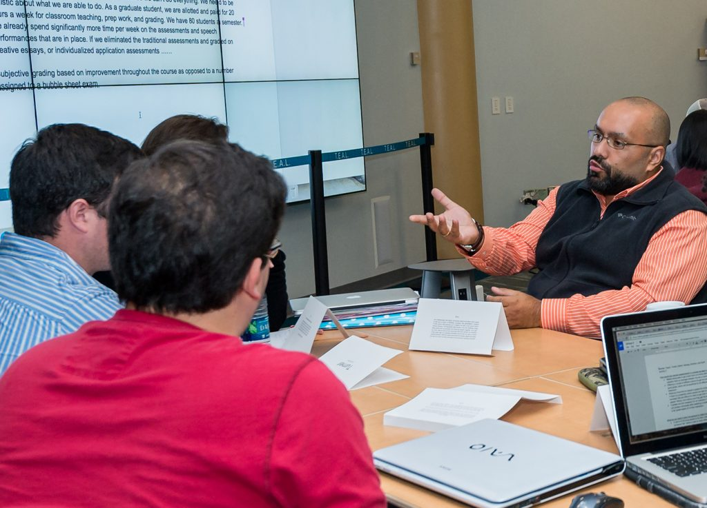 Members of GTA Academy of Excellence, designed to support and train GTAs, assist Professor Amy Nelson during her class on Contemporary Pedagogy.